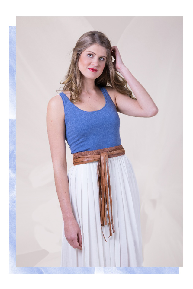 Styling Resolutions - White flowy skirt belted with a tassel tan belt